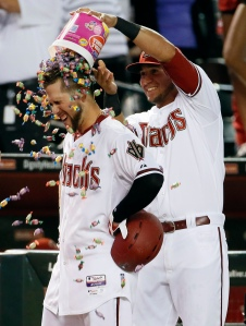 Arizona Diamondbacks' Ender Inciarte has bubble gum dumped on him by David Peralta after a walk-off RBI single to end a 10-inning  baseball game against the Los Angeles Dodgers, Friday, April 10, 2015, in Phoenix. The Diamondbacks won 4-3. (AP Photo/Matt York)